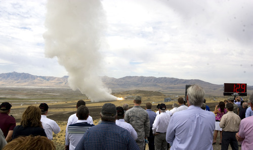 Al Hartmann  |  The Salt Lake Tribune Alliant Techsystems employees and guests watch the GEM-60 solid rocket motor testing from one-half mile away Thursday, Sept. 6, at ATK's testing facility west of Brigham City. The 60-inch diameter graphite epoxy motor is a commercially provided low-cost propulsion system.