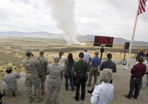 l Hartmann  |  The Salt Lake Tribune Alliant Techsystems employees and VIP guests watch the GEM-60 solid rocket motor testing from one-half mile away Thursday, Sept. 6, at ATK's testing facility west of Brigham City. The 60-inch diameter graphite epoxy motor is a commercially provided low-cost propulsion system.