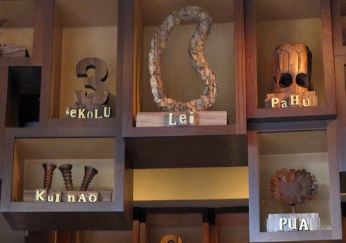 Objects and their Hawaiian names are seen along the wall in The Olelo Room, a bar at Disney's Aulani resort in Kapolei, Hawaii on Aug. 31, 2012. Many Hawaii resorts are edging away from kitschy marketing inventions and are instead turning to Hawaii's actual rich traditions to make trips special for travelers. (AP Photo/Audrey McAvoy)