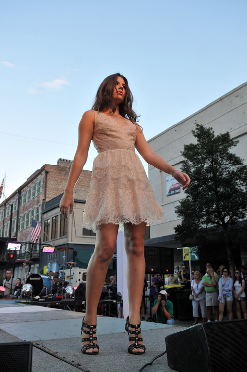 A model makes her turn on the catwalk, located on Broughton near Drayton Street, Thursday evening Sept. 6, 2012 during Savannah's Second Fashion's Night Out in Savannah, Ga. Clothing from local businesses was highlighted during fashion shows held throughout the event. (AP Photo/The Morning News, Richard Burkhart)