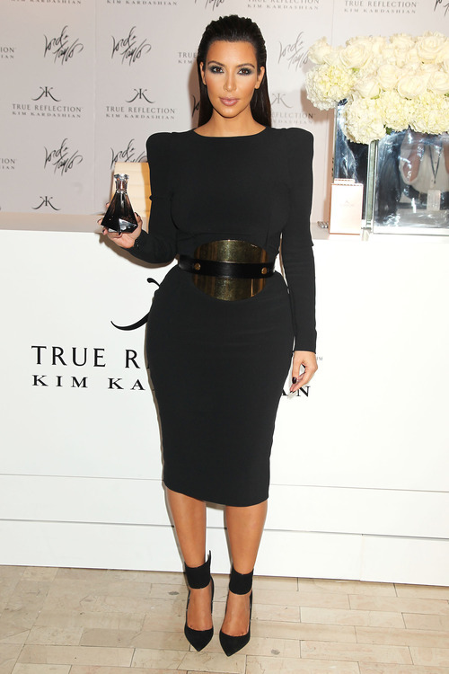 This image released by Starpix shows TV personality Kim Kardashian at a Fashion's Night Out event at Lord & Taylor, Thursday, Sept. 6, 2012 kicking off Fashion Week in New York. (AP Photo/Starpix, Dave Allocca)