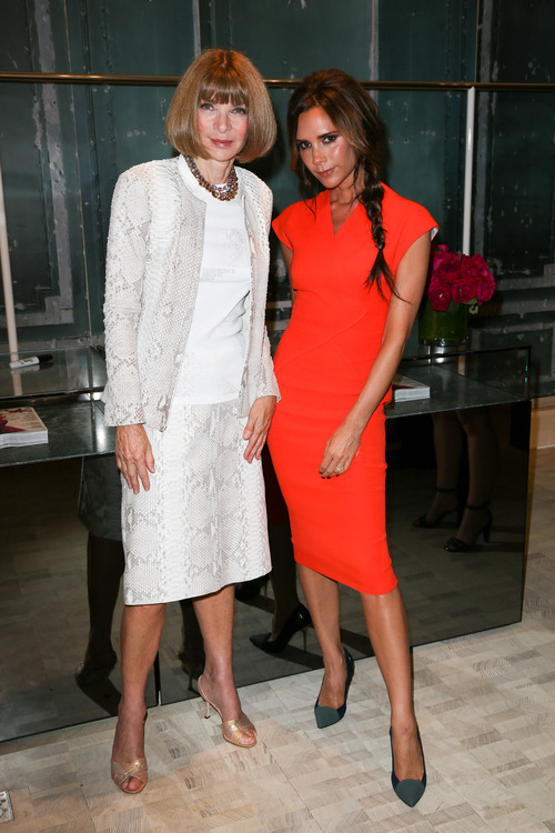This image released by Starpix shows Vogue editor Anna Wintour, left, and fashion designer Victoria Beckham at a Fashion's Night Out event at Bergdorf Goodman, Thursday, Sept. 6, 2012, kicking off Fashion Week in New York. (AP Photo/Starpix, Andrew Toth)