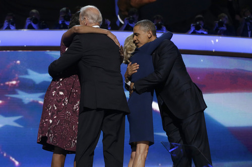 First lady Michelle Obama, left, Vice President Joe Biden, Dr. Jill Biden, and President Barack Obama hug each other after President Obama's speech to the Democratic National Convention in Charlotte, N.C., on Thursday, Sept. 6, 2012. (AP Photo/Charles Dharapak)