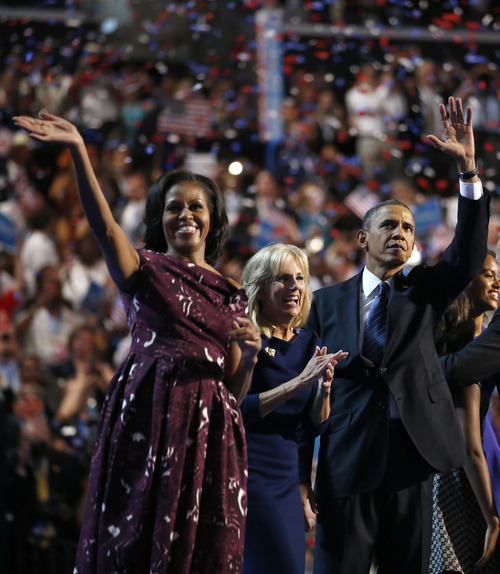 First lady Michelle Obama, Vice President Biden's wife Dr. Jill Biden, and President Barack Obama wave after President Obama's speech to the Democratic National Convention in Charlotte, N.C., on Thursday, Sept. 6, 2012. (AP Photo/Jae C. Hong)