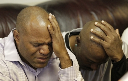 Eugene Nelson, left, and Kevin Nelson, family members of Allen Nelson, show their emotions during a news conference after attorneys filed a wrongful-death case against Salt Lake City police for the Taser death of Allen Nelson Thursday, Sept. 6, 2012, in Salt Lake City. Family members say Allen Nelson was pulled over in June for reasons police won't detail. An eyewitness says she overheard police say they used a stun gun on the man. (AP Photo/Rick Bowmer)