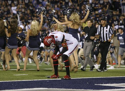 Scott Sommerdorf  |  The Salt Lake Tribune              Utah WR Dres Anderson collapsed as the on field celebration began after the USU Aggies beat Utah 27-20 in OT, Friday, September 7, 2012.