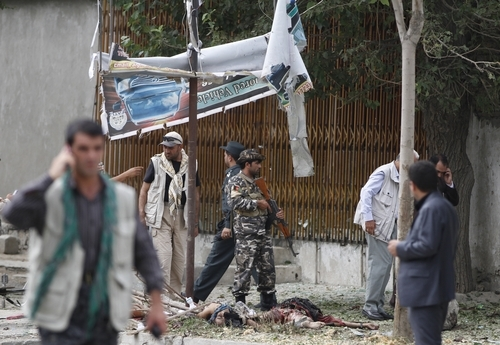 A member of the Afghan security forces stands guard at the scene of suicide bombing in Kabul Afghanistan, Saturday, 8, 2012. Afghan authorities say a suicide bomber has blown himself up near NATO headquarters in Kabul, killing at least 6 people (AP Photo/Ahmad Jamshid)