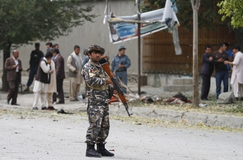 A member of the Afghan security forces stands guard at the scene of a suicide bombing in Kabul Afghanistan, Saturday, 8, 2012. Afghan authorities say a suicide bomber has blown himself up near NATO headquarters in Kabul, killing at least 6 people. (AP Photo/Ahmad Jamshid)