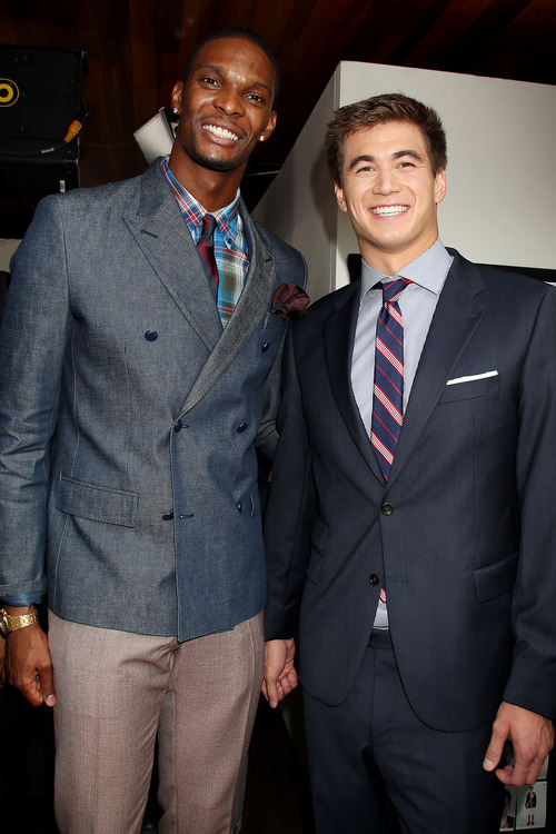 This image released by Starpix shows NBA basketball player Chris Bosh, left, and U.S. Olympic  swimmer Nathan Adrian at the presentation for the 2013 Tommy Hilfiger Mens Collection Friday, Sept. 7, 2012 during Fashion Week in New York. (AP Photo/Starpix, Dave Allocca)