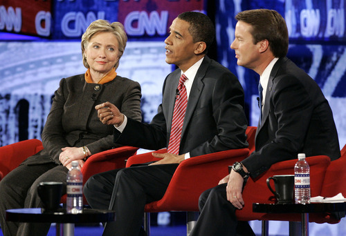 FILE - In this Jan. 21, 2008 file photo, Democratic presidential hopefuls, from left, Sen. Hillary Rodham Clinton, D-N.Y., Sen. Barack Obama, D-Ill., and former North Carolina Sen. John Edwards, participate in a Democratic presidential debate in Myrtle Beach, S.C. Finally, the fall season delivers the matchup Americans have been waiting for, President Barack Obama goes one-on-one with Republican Mitt Romney in three prime-time debates. With the race a dead heat, the debates take on an oversized role in the few weeks between now and Election Day. One small mistake or impression _ a glance at a watch, repetitive sighing _ could roil the campaign for days and linger in voters' mind. This is especially true for two polished candidates who will have the soundbites and rhetoric down cool.   (AP Photo/Mary Ann Chastain, File)