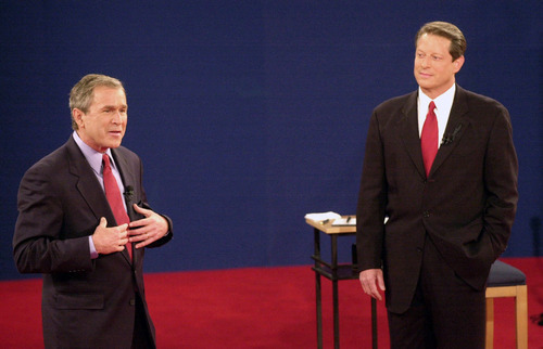 FILE - In this Oct. 17, 2000 file photo, Republican presidential candidate, Texas Gov. George W. Bush, left, speaks as Democratic presidential candidate Vice President Al Gore watches during their third and final debate at Washington University in St. Louis. Finally, the fall season delivers the matchup Americans have been waiting for, President Barack Obama goes one-on-one with Republican Mitt Romney in three prime-time debates. With the race a dead heat, the debates take on an oversized role in the few weeks between now and Election Day. One small mistake or impression _ a glance at a watch, repetitive sighing _ could roil the campaign for days and linger in voters' mind. This is especially true for two polished candidates who will have the soundbites and rhetoric down cool.  (AP Photo/Ed Reinke, File)