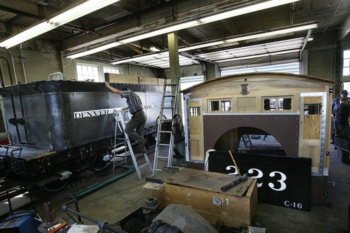 Scott Sommerdorf  |  The Salt Lake Tribune              Maynard Morris climbs a ladder to get a look at the progress being made on the tender car for an engine that a group of volunteers in Ogden comes together every Saturday to work on. They are restoring a narrow gauge locomotive at the Union Station Trainmen's Building, Saturday, September 8, 2012.