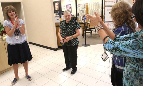 Rick Egan    The Salt Lake Tribune    JCPenney employees clap for Merle Hansen (center) in honor of her 41 years of service, Thursday, Aug. 16, 2012. Hansen has been a store clerk at the  JCPenney store in the Valley Fair Mall for 41 years. She was honored by her work colleagues on Thursday morning, before the store opened to customers.