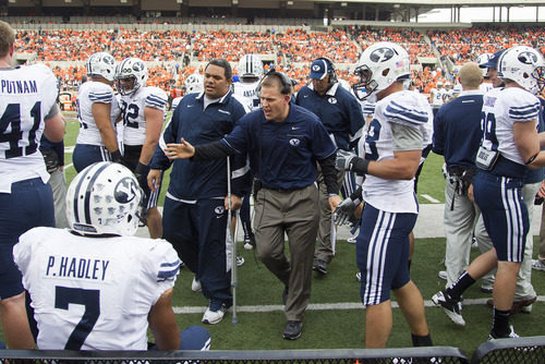 Mark A. Philbrick | BYU BYU def. backs coach Nick Howell (Center_.