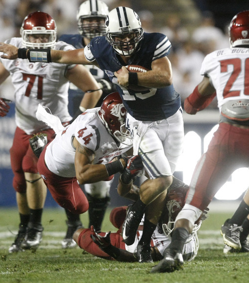 Chris Detrick     The Salt Lake Tribune Brigham Young Cougars quarterback Riley Nelson (13) runs the ball past Washington State Cougars linebacker Tana Pritchard (44) during the first half of the game against Washington State at LaVell Edwards Stadium in Provo on Thursday, Aug. 30, 2012.