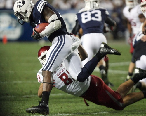 Kim Raff | The Salt Lake Tribune Brigham Young Cougars running back Jamaal Williams (21) makes a run as Washington State Cougars linebacker Logan Mayes (83) makes a tackle during BYU's home opener at LaVell Edwards Stadium in Provo on Aug. 30, 2012.