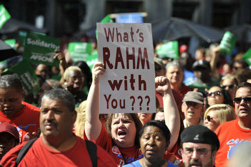 Demonstrators with the Chicago Teachers Union rally at Daley Plaza in Chicago, Monday, Sept. 3, 2012. Seeking to mount a show of strength, thousands of union workers staged a rally to support the Chicago Teachers Union in its contract talks with the city's school district. (AP Photo/Chicago Sun-Times, Brian Jackson)  CHICAGO LOCALS OUT; MAGS OUT