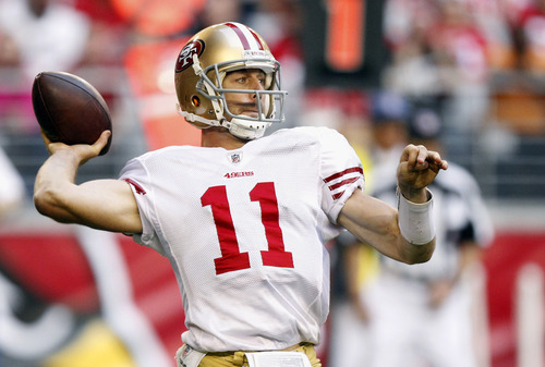 Alex Smith and the San Francisco 49ers are Kurt Kragthorpe's Super Bowl pick from the NFC, thanks to one of the league's best defenses, an upgraded group of receivers and the further development of Smith under coach Jim Harbaugh and offensive coordinator Greg Roman.  (AP Photo/Paul Connors)