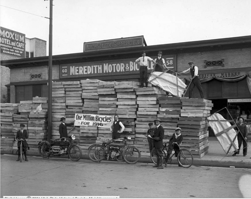 Image shows several men standing on and around the huge shipment of bicycles which have been sent to the Meredith Motor and Bicycle, May 9, 1916. Courtesy of Utah Historical Society