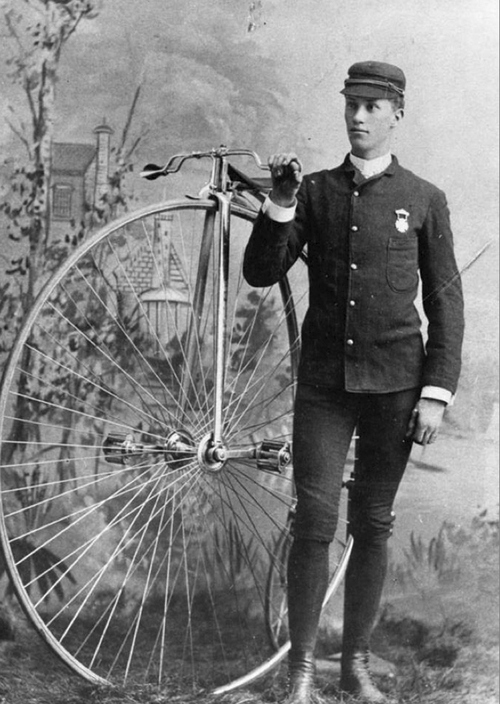 Image shows Phil Brooks and his bicycle around 1915. Courtesy of Utah Historical Society