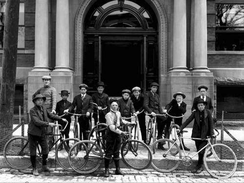 Image shows the boys of the YMCA bicycle club posing for a photograph in front of the YMCA building on State Street, April 28, 1906. Courtesy of Utah Historical Society