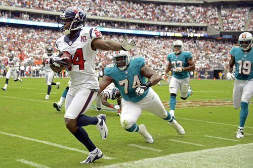Houston Texans cornerback Johnathan Joseph (24) returns an interception as Miami Dolphins guard John Jerry (74) dives to tackle him in the second quarter of an NFL football game, Sunday, Sept. 9, 2012, in Houston. (AP Photo/Dave Einsel)