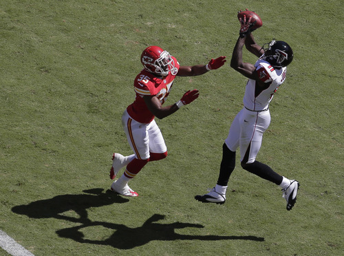 Atlanta Falcons wide receiver Julio Jones (11) catches a touchdown pass while covered by Kansas City Chiefs defensive back Jacques Reeves (35) during the first half of an NFL football game at Arrowhead Stadium in Kansas City, Mo., Sunday, Sept. 9, 2012. (AP Photo/Charlie Riedel)