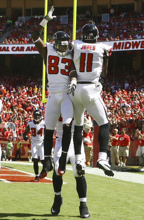 Atlanta Falcons wide receiver Julio Jones (11) celebrates his touchdown with teammate Harry Douglas (83) during the first half of an NFL football game against the Atlanta Falcons at Arrowhead Stadium in Kansas City, Mo., Sunday, Sept. 9, 2012. (AP Photo/Ed Zurga)