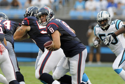 Houston Texans quarterback Matt Schaub (8) scrambles against the Carolina Panthers during the first half of an NFL preseason football game in Charlotte, N.C., Saturday, Aug. 11, 2012. (AP Photo/Mike McCarn)