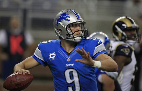 Detroit Lions quarterback Matthew Stafford (9) looks downfield during the first quarter of an NFL football game against the St. Louis Rams in Detroit, Sunday, Sept. 9, 2012. (AP Photo/Carlos Osorio)