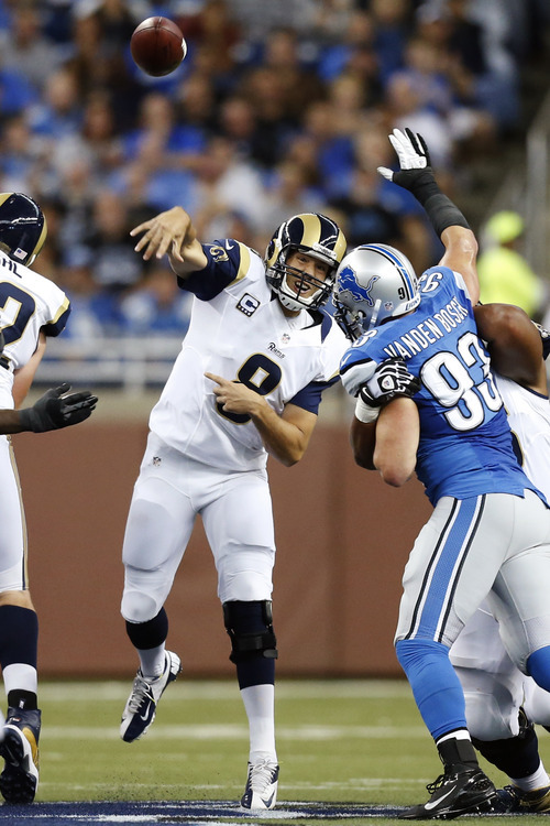 St. Louis Rams quarterback Sam Bradford (8) passes the ball as Detroit Lions defensive end Kyle Vanden Bosch (93) rushes in the first quarter of an NFL football game in Detroit, Sunday, Sept. 9, 2012. (AP Photo/Rick Osentoski)