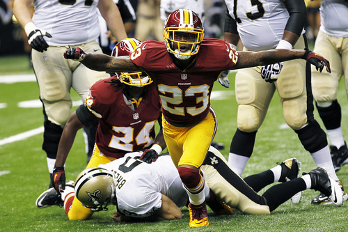 Washington Redskins cornerback DeAngelo Hall (23) reacts after sacking New Orleans Saints quarterback Drew Brees (9) in the first half of an NFL football game in New Orleans, Sunday, Sept. 9, 2012. (AP Photo/Bill Haber)