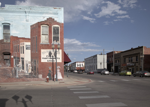 This photo from Sept. 4, 2012 shows the Isis movie theatre building in Crete, Neb., far right. The Isis Theatre hasn't changed much since it opened 86 years ago, but as the movie industry phases out the traditional 35 mm film reels in favor of digital media, the Isis' owner must come up with $85,000 to buy new projection equipment, computers, a sound system and even a different screen. It is a huge financial burden for the small theatre. (AP Photo/Nati Harnik)