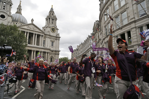 Olympic and Paralympic Games volunteers parade following the Team GB Olympic and Paralympic teams in the streets of London, Monday, Sept. 10, 2012. Our Greatest Team Parade, the procession of athletes, celebrates the achievements of British Olympians and Paralympians at the London 2012 Games. (AP Photo/Lefteris Pitarakis)