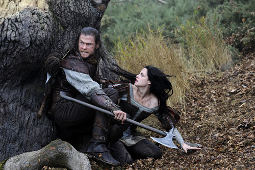 This film image released by Universal Pictures shows Chris Hemsworth, left, and Kristen Stewart in a scene from