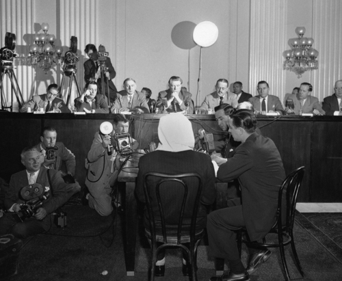 FILE - In this Feb. 6, 1952 file photo, a masked former Polish soldier testifies on the 1940 Katyn Forest massacre to a house committee in Washington. Documents released Monday, Sept. 10, 2012 lend weight to the belief that suppression within the highest levels of the U.S. government helped cover up Soviet guilt in the killing of some 22,000 Polish officers and other prisoners in the Katyn forest and other locations in 1940. In a final report released in 1952, the committee declared there was no doubt of Soviet guilt, and called the massacre
