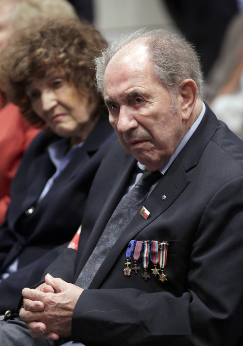 Antoni Chroscielewski, 88, and his wife Lunia, 80, of New York, attend an event on Capitol Hill to announce the release of information about the Katyn Forest massacre of Polish Army officers and others captured by the Soviets during their invasion of Poland during World War II, in Washington, Monday, Sept. 10, 2012.  Antoni Chroscielewski was a member of the free Polish army during World War II.  (AP Photo/J. Scott Applewhite)