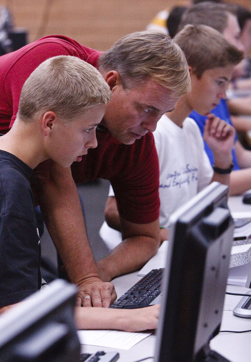 Leah Hogsten  |  The Salt Lake Tribune Michael Corbett teaches his students at Lehi Junior High how to use a search engine September 5, 2012. The Utah Exploring Computer Science Initiative project seeks to address the problem of decreased enrollments in high school computer science classes and the increased need for computing professionals in the workforce.
