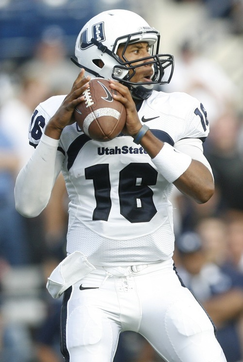 Tribune file photo  USU quarterback Chuckie Keeton looks for a receiver in a 2011 game against BYU.