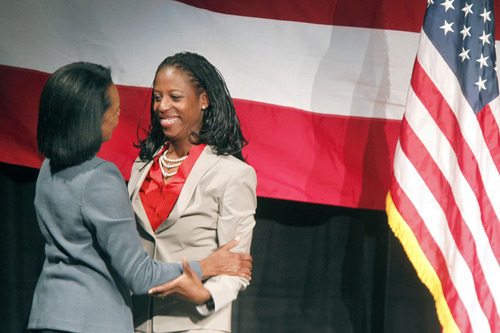 Al Hartmann  |  The Salt Lake Tribune Former Secretary of State Condoleezza Rice, left, hugs Saratoga Springs Mayor Mia Love. Rice was appearing at a fundraiser Friday for Love's 4th Congressional District campaign at Thanksgiving Point.