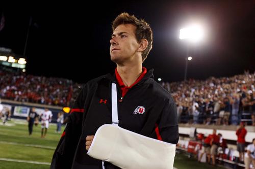Injured Utah quarterback Jordan Wynn walks off the field after the overtime loss at Utah State on Friday, Sept. 7, 2012. (AP Photo/The Salt Lake Tribune, Trent Nelson)