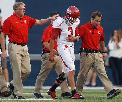 An injured Jordan Wynn leaves the field during the second quarter against Utah State on Friday, Sept. 7, 2012, in Logan, Utah. (AP Photo/The Salt Lake Tribune, Trent Nelson)