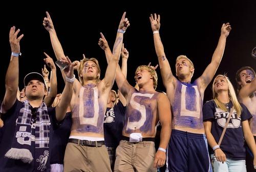 Trent Nelson  |  The Salt Lake Tribune Utah State fans cheer as Utah State hosts the University of Utah, college football in Logan, Utah, Friday, September 7, 2012.