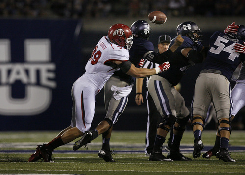 Scott Sommerdorf  |  The Salt Lake Tribune              Utah DL Joe Kruger hits USU QB Chuckie Keeton from behind and causes this fumble that was recovered by Utah's Nate Fakahafua during second half play. Later Kruger was thrown out of the game for fighting. The USU Aggies beat Utah 27-20 in OT, Friday, September 7, 2012.