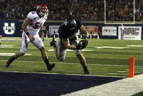 Scott Sommerdorf  |  The Salt Lake Tribune              USU's Kellen Bartlett takes in a 4 yard pass for a TD to give USU a 20-13 lead. The USU Aggies beat Utah 27-20 in OT, Friday, September 7, 2012.