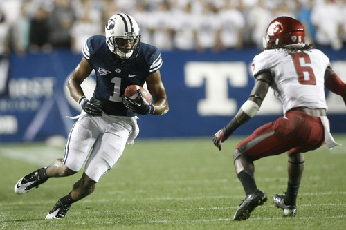 Chris Detrick     The Salt Lake Tribune Brigham Young Cougars wide receiver Ross Apo (1) runs the ball past Washington State Cougars cornerback Damante Horton (6) during the first half of the game against Washington State at LaVell Edwards Stadium Thursday August 30, 2012. BYU is winning the game 24-6.