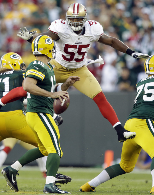 San Francisco 49ers' Ahmad Brooks (55) leaps up to sack Green Bay Packers quarterback Aaron Rodgers (12) during the second half of an NFL football game Sunday, Sept. 9, 2012, in Green Bay, Wis. The 49ers won 30-22. (AP Photo/Jeffrey Phelps)