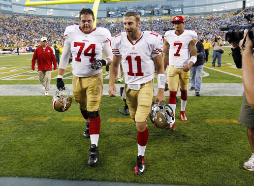 San Francisco 49ers' Alex Smith (11) and  Joe Staley (74) walk off the field after the second half of an NFL football game against the Green Bay Packers Monday, Sept. 10, 2012, in Green Bay, Wis. (AP Photo/Mike Roemer)