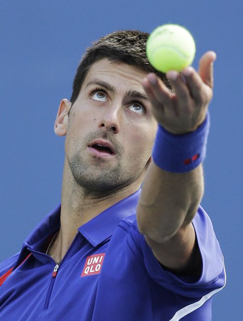Serbia's Novak Djokovic serves to Britain's Andy Murray during the championship match at the 2012 US Open tennis tournament,  Monday, Sept. 10, 2012, in New York. (AP Photo/Mike Groll)