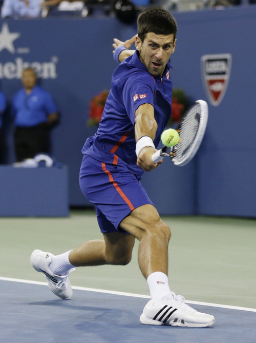 Serbia's Novak Djokovic returns a shot to Britain's Andy Murray during the championship match at the 2012 US Open tennis tournament,  Monday, Sept. 10, 2012, in New York. (AP Photo/Mike Groll)